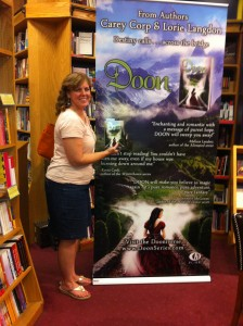 Nima with the book poster for Doon.