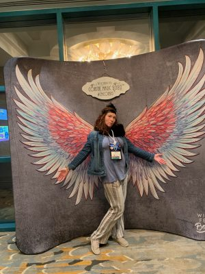 Image of lady standing in front of angel wings