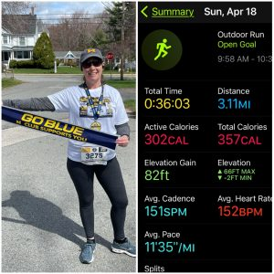 photo of me finishing my virtual race, with a screen shot of my race stats