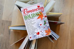 image of book (book cover of Romancing the Holidays Volume Two) sitting on top of other books
